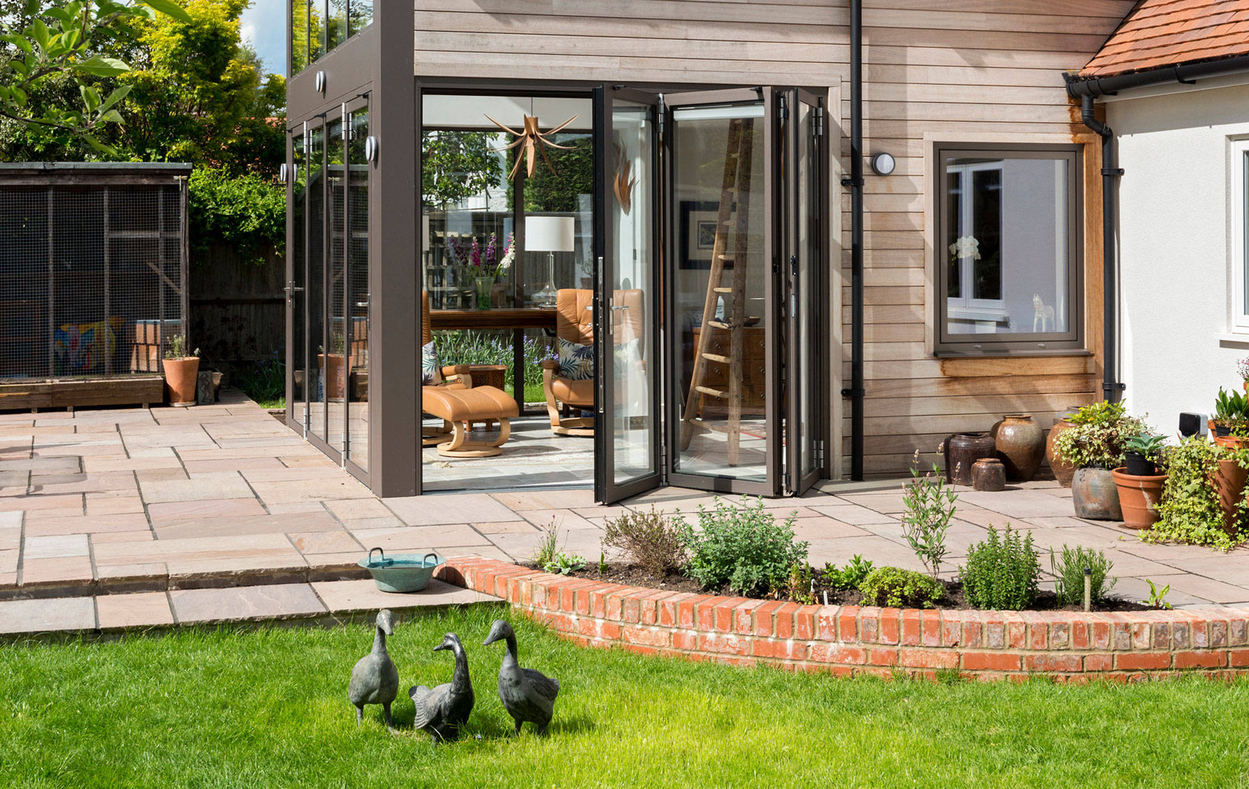 View from the outside of Aluminium full height glazing system installed in an Oxfordshire Cottage