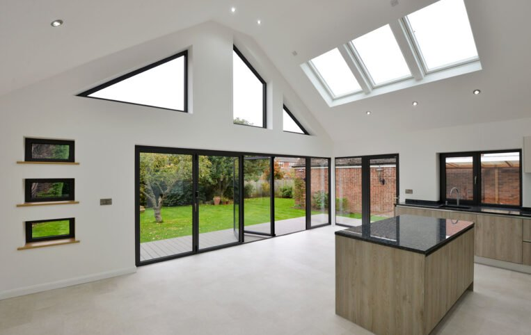 Bifolding Aluminium doors with rooflights and bespoke windows for bungalow extension in essex