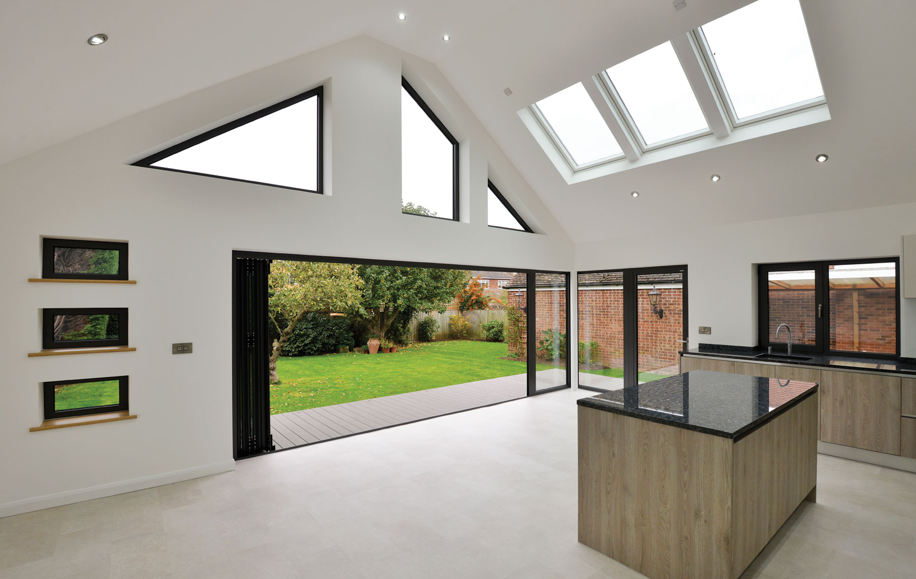 Bifolding Aluminium doors with rooflights and bespoke windows for bungalow extension in essexLIDING DOORS AND BESPOKE WINDOWS FOR EXTENSION