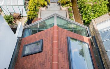 Aluminium wintergarden with bifolding doors and rooflights in Chiswick
