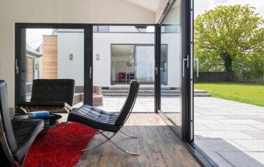 Aluminium sliding doors opens garden in Essex
