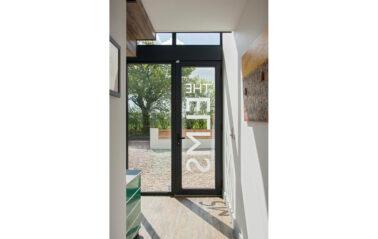 Aluminium entrance door in curtain walling for refurbised hime in Essex