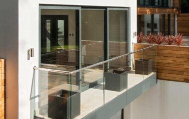 Slimline ODC300 sliding systems with glass balcony on stunning new build