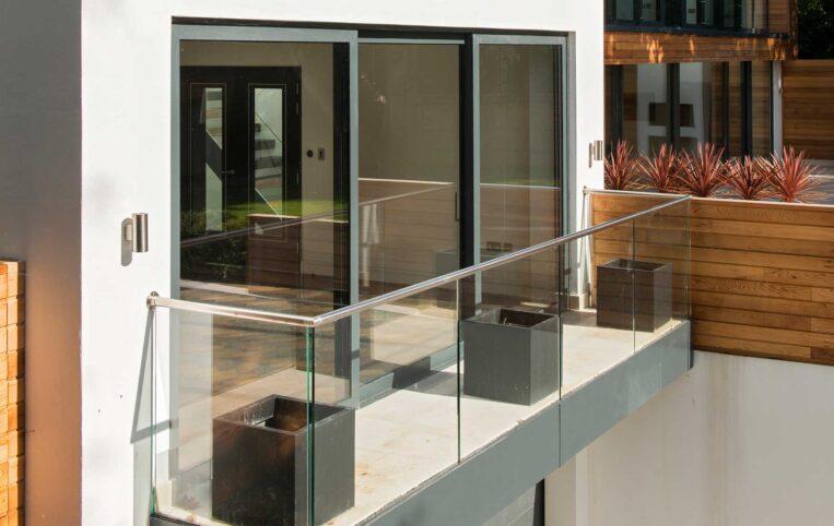 Slimline ODC300 sliding systems with glass balcony on stunning new build