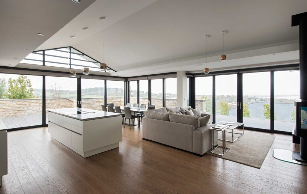 sliding door systems and curtain glazing for living area of coastal home