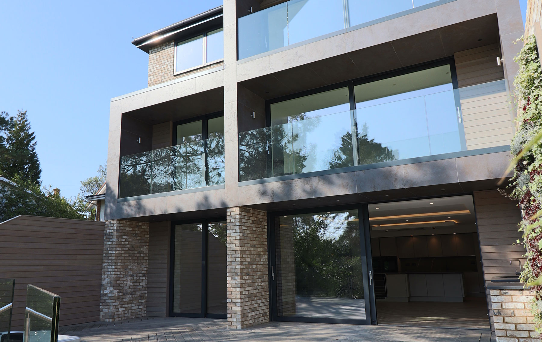 Contemporary sliding doors and balustrades for new build