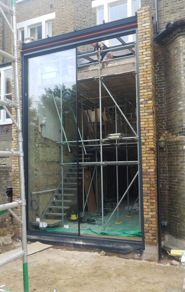 Sliding door panel being fitted to period home