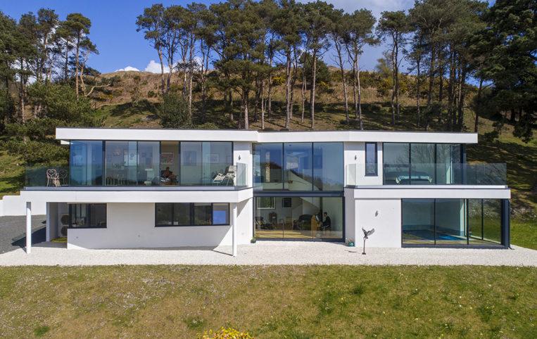 New build in Dorset with our ODC SL320 aluminium sliding doors, bespoke windows and doors