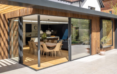 Corner glazing created by two sets of sliding doors